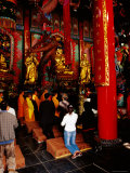 Monk and Devotees Praying at Yuantong Temple, Kunming, Yunnan, China Photographic Print by Richard I'Anson