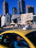 Taxi Driving Past Federation Square, Melbourne, Victoria, Australia Photographic Print by John Banagan