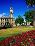 Floral Display with Bendigo's Old Post Office Building in Background, Bendigo, Victoria, Australia Photographic Print by Glenn Beanland