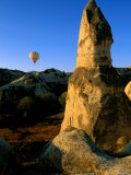 Tufa Formation with Hot-Air Balloon in the Background, Cappadocia, Nevsehir, Turkey Photographic Print by John Elk III
