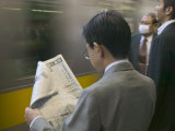 Man Reading Newspaper at Shinjuku Station, Tokyo, Kanto, Japan Photographic Print by Brent Winebrenner