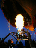 Man Operating a Flame to Fill a Hot-Air Balloon, Goreme, Nevsehir, Turkey Photographic Print by John Elk III