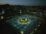 Thousands of pilgrims circle the Kaaba in illuminated view at night Photographic Print by Thomas J. Abercrombie