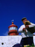 Lone Bagpiper Plays Beneath the Cabo Da Roca Lighthouse, Sintra, Estremadura, Portugal Photographic Print by Anders Blomqvist