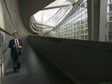 Man Walking Outside the Tokyo International Forum, Tokyo, Kanto, Japan Photographic Print by Brent Winebrenner