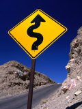 Sign Warning of a Curvy Road, Near the Artist's Palette, Nevada Photographic Print by Dominic Bonuccelli