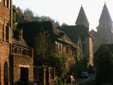 Village Buildings with Abbey St. Foy in Background, Conques, Midi-Pyrenees, France Photographic Print by John Elk III