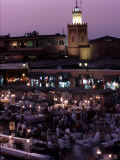 Djemma El-Fna at Dusk with Mosque Behind, Marrakesh, Morocco Photographic Print by Doug McKinlay