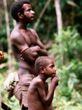 Man and Boy Watching Work, Oriomo Plateau, Western, Papua New Guinea Photographic Print by Oliver Strewe