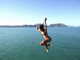 Woman Jumping off Tolaga Bay Wharf, New Zealand Photographic Print by Oliver Strewe