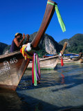 Fisherman on Longtail Boat About to Depart from Ao Ton Sai Beach, Ko Phi-Phi Don, Krabi, Thailand Photographic Print by Dominic Bonuccelli