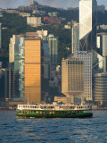 Star Ferry Crossing Hong Kong Harbour with the Towers of Hong Kong Island Beyond, Hong Kong, China Photographic Print by Greg Elms