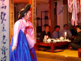 Woman in Costume Performing for Table of Men Dining at Sanchon, Insadong, Seoul, South Korea Photographic Print by Anthony Plummer