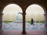 People Walking Past Arches of Antique Cloister at Iglesia de San Francisco, La Paz, Bolivia Photographic Print by Brent Winebrenner