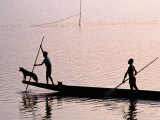 Two Men and a Dog in a Canoe, Silhouetted, Rabaul, East New Britain, Papua New Guinea Photographic Print by Oliver Strewe