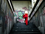 Woman Climbing Graffiti Stairwell, Belgrade, Serbia Photographic Print by Doug McKinlay
