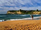 Surfer on Avalon Beach, Bilgola Headland in Background, Sydney, New South Wales, Australia Photographic Print by Ross Barnett