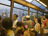 Passengers on the Peak Tram Ascending Victoria Peak, Hong Kong, China Photographic Print by Greg Elms