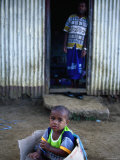Young Boy Playing in Box Outside Home, Viti Levu, Western Division, Fiji Photographic Print by Daniel Boag