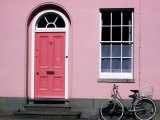 Bicycle Leaning Against Pink House, Oxford, Oxfordshire, England Photographic Print by David Tomlinson