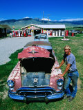 Petroliana Collector Standing Next to Old Car, Montana Photographic Print by Holger Leue