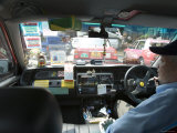 Driver in a Hong Kong Taxi, Hong Kong, China Photographic Print by Greg Elms