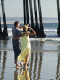 Couple on Beach Below Pier, Pismo Beach, California Photographic Print by Brent Winebrenner