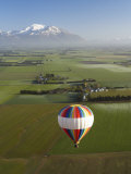 Hot-Air Balloon near Methven with Mountains in Distance, New Zealand Photographic Print by David Wall