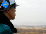South Korean Rok Soldier in Joint Security Area Looking to the North Across Dmz, Seoul, South Korea Photographic Print by Anthony Plummer