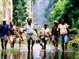 Travelling Magistrates Wading through Stream, Oriomo Plateau, Western, Papua New Guinea Photographic Print by Oliver Strewe