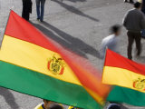 Bolivian Flags Flying Outside El Estado Hernando Siles, La Paz Photographic Print by Brent Winebrenner