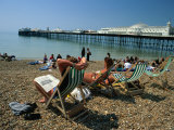 Sunbathers on Deckchairs Near Brighton Pier, Brighton, Brighton and Hove, England Photographic Print by Christer Fredriksson