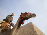Tourist on Camel near Pyramid, Cairo Photographic Print by Holger Leue
