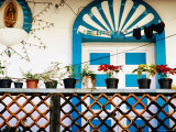 Flowerpots and Painted Doorway on a Balcony, Mexico Photographic Print by Richard Cummins
