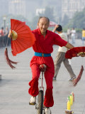 Fan Fluttering Unicyclist on the Bund Promenade, Shanghai, China Photographic Print by Greg Elms