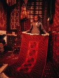 Carpet Trader Displaying a Woolen Carpet, Peshawar, North-West Frontier Province, Pakistan Photographic Print by Richard I&#39;Anson