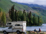 RV Camping Couple Stop for a Break on the Shores of Long Lake along the Glenn Highway, Alaska Photographic Print by Brent Winebrenner