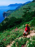 Hiker on Trail Above Corniglia, Cinque Terre, Liguria, Italy Photographic Print by John Elk III