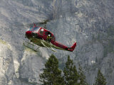 Rescue Helicopter in Front of One of Yosemite Valley's Big Walls Fotoprint van Brent Winebrenner