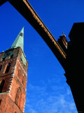 Spire of Jacobikirche Under Arch Spanning Engelsgrube, Lubeck, Schleswig-Holstein, Germany Photographic Print by Martin Lladó