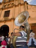 Tuba Player in Front of Iglesia San Juan Bautista de Subtiava During Semana Santa, Leon, Nicaragua Fotografisk tryk af Margie Politzer