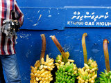 Watch Seller and Bunches of Bananas Outside Vegetable Market, Male, Kaafu, Maldives Photographic Print by Felix Hug