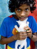 Girl in Superman Dress Holding Her Kitten, Male, Kaafu, Maldives Photographic Print by Felix Hug