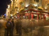 People Walking Past the Temple Bar at Night, Dublin Photographic Print by Holger Leue