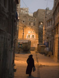 Woman Walking in Old Town, Dusk, San'a, Yemen Photographic Print by Holger Leue