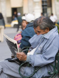 Man Reading Newspaper, Plaza de Armas, Peru Photographic Print by Brent Winebrenner