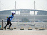 Person Rollerblading Past World Cup Stadium, North of River, Seoul, South Korea Photographic Print by Anthony Plummer