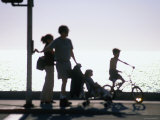 Family Takes an Early Evening Stroll along Redondo Beach in Los Angeles, Los Angeles, California Photographic Print by Ray Laskowitz