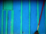 Red Broom Stands Out against a Wall in Pital, Campeche, Mexico Photographic Print by Jeffrey Becom