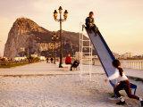 Playground at Bay of Algeciras with Rock of Gibraltar in Background, Andalucia, Spain Fotografie-Druck von Witold Skrypczak